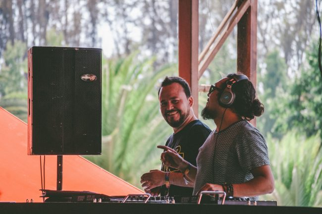 dj in front of decks and dj speaker